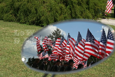 Kansas Patriot Guard Blocking Protesters, Through The Mirror Of The Fallen Soldiers Bike.