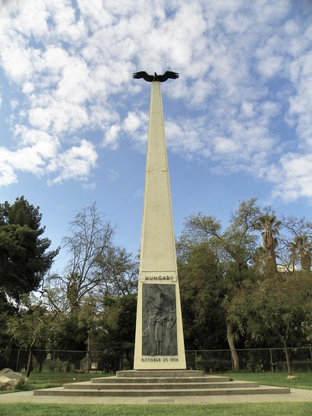 The Memorial is at 1956 W 6th Street, immediately adjacent to the north side of MacArthur Park.