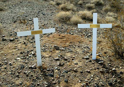 Two crosses mark the memorial site of Judson Brohmer, an aerial photographer, and Maj. Aaron George, a test pilot, who were both killed in an F-16 crash near China Lake Naval Air Warfare Center July 17, 2001.