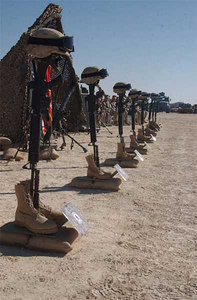 Rifles stood, covered by helmets and adorned with identification tags, between eight sets of boots to commemorate the Marines of BLT 2/1 who died during Operation Steel Curtain.