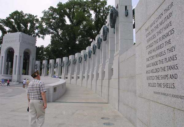 A World War II veteran looks at the national World War II Memorial on the mall in Washington, D.C.