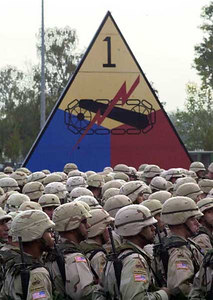 Soldiers of V Corps' 1st Armored Division stand in formation during the dedication of a memorial to division Soldiers killed in Operation Iraqi Freedom on Minue Field in Wiesbaden, Germany, Oct. 7, 2004.