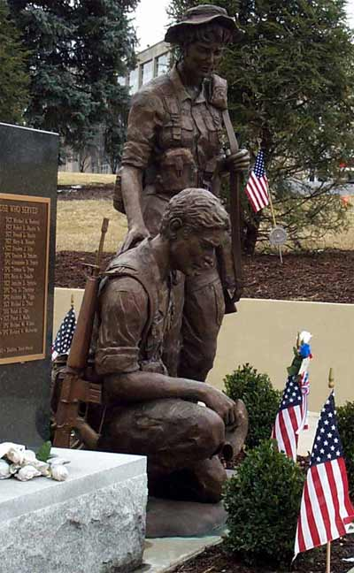 Two bronze soldiers in desert battle dress uniforms reflect on the loss of their comrades. The statues, created by sculptor Susan Wagner of Pittsburgh, are part of the 14th Quartermaster Detachment Memorial at the Army Reserve center in Greensburg, Pa.
