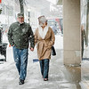 Danny Normile and Paulette Roy-Tata walk through the snow during the Memories of Main Street event in Fitchburg on Saturday, December 9, 2017. SENTINEL & ENTERPRISE / Ashley Green