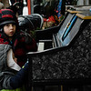 Vinny and Bobby Alexander play the public piano in front of Gallery Sitka during the Memories of Main Street event in Fitchburg on Saturday, December 9, 2017. SENTINEL & ENTERPRISE / Ashley Green