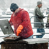 Trevor Bonilla roasts chestnuts during the Memories of Main Street event in Fitchburg on Saturday, December 9, 2017. SENTINEL & ENTERPRISE / Ashley Green