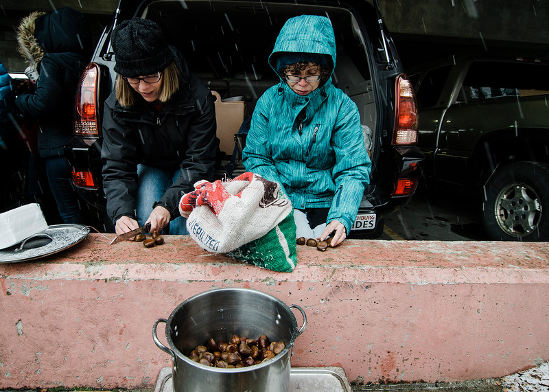 Amy Bonilla and Marcia Ladd prepare chestnuts for the fire during the Memories of Main Street event in Fitchburg on Saturday, December 9, 2017. SENTINEL & ENTERPRISE / Ashley Green