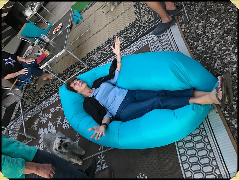 Gloria enjoying her Vagina chair.