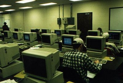 the original computer lab at Liberty University - yes those are Zenith 386 computers, running MS-DOS.  Ellen's head is visible sitting next to the door :)