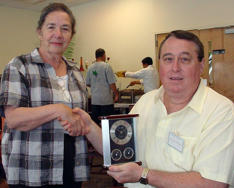 Judith Murphy presenting George Tremmel with SPMC Lifetime Achievement award (June 26, 2004, near Raleigh, NC)