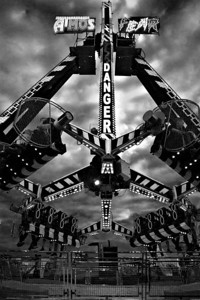 A shot I took whilst at the Newcastle Hoppings annual fun fair.  I love it as a strong geometrical image and one that screams danger at you in keeping with the Atmos Fear name of the ride.  Although the original was fairly colourful the b+w treatment works better from a dramatic point of view.
