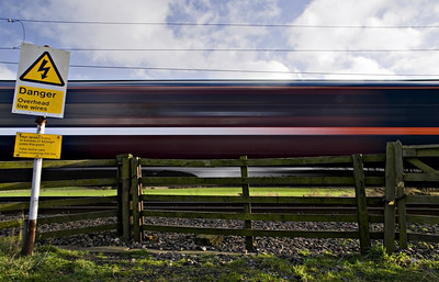 Taken in the days leading up to National Express taking over running of the English east coast main railway line from the Great North Eastern Railway (GNER) when some rolling stock was having the livery changed over.  Obviously I used a slow shutter speed to get the motion blur but the funny thing on examining the shot was the blending, half way down the carriage(s), from the orange GNER strip to the white/silver National Express one........I therefore called this image 'Transition'