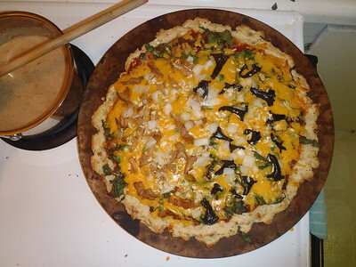 Cate's homemade pizza with fresh hedgehogs on the left half and black trumpets on the right half.