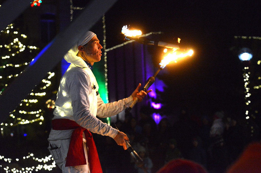 . Sven Jorgensen performs for the crowd at the enorah lighting on the Pearl Street Mall on Monday evening. For more photos go to www.dailycamera.com Paul Aiken / Staff Photographer / Dec 26 2016