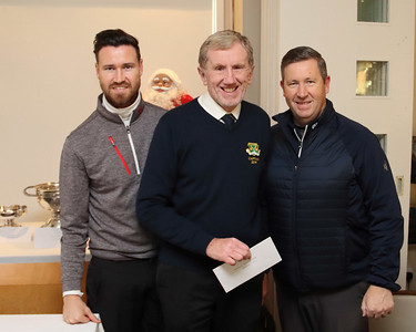Winners of the Club Foursomes - Ashton & Derek McCormack receive their prize from Captain Jim