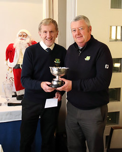 Andy Kavanagh, Golfer of the Year 2019, being presented with the Trophy by Captain Jim