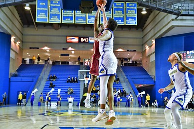 Joe Chealey puts up a jump shot against Delaware's Eric Carter