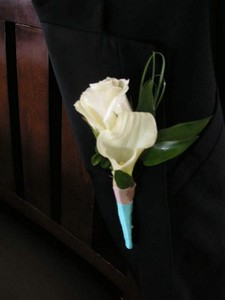 Double calla with mixed greens- ( groom) $30