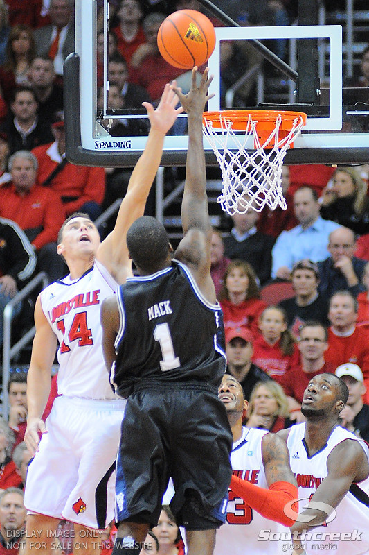 Butler guard Shelvin Mack (1) shoots over Louisville guard Kyle Kuric (14) during the game.  Louisville leads Butler 41-23 at the half  at the KFC Yum Center in Louisville, Kentucky.