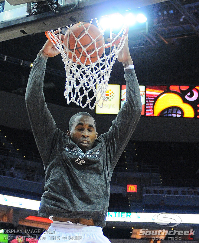 Louisville guard Chris Smith (5) before the game.  At the KFC Yum Center in Louisville, Kentucky.