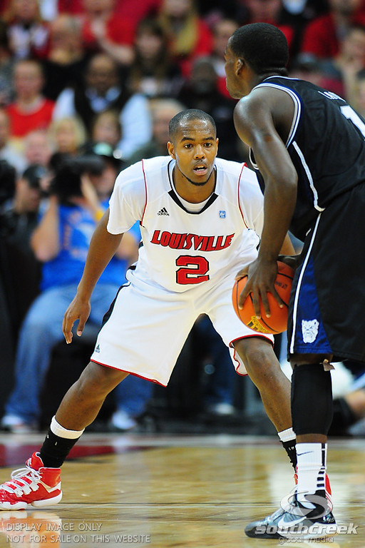 Louisville guard Preston Knowles (2) guarding Butler guard Shelvin Mack during the game.  Louisville leads Butler 41-23 at the half  at the KFC Yum Center in Louisville, Kentucky.
