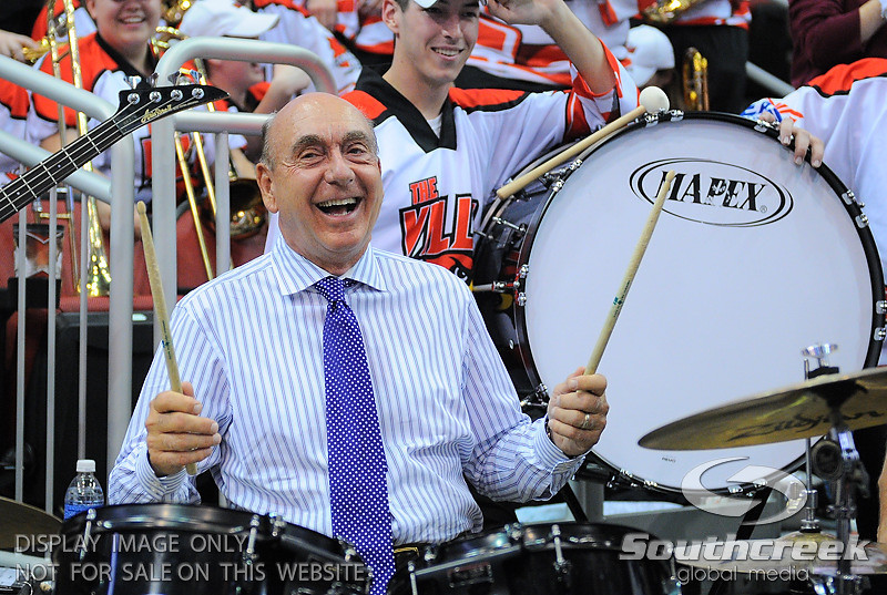 Dick Vitale playing the drums with the Louisville band before the game.  At the KFC Yum Center in Louisville, Kentucky.