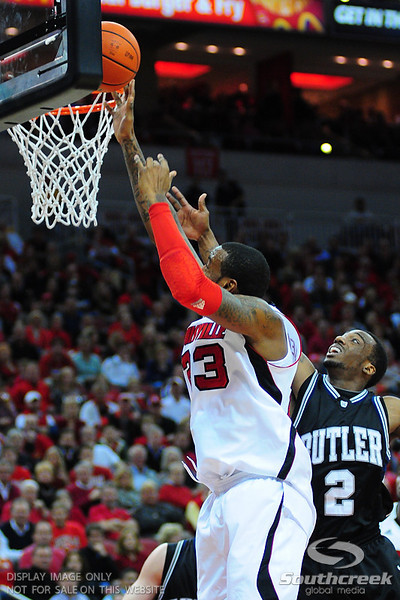 Louisville forward Terrence Jennings (23) goes up strong over Butler guard Shawn Vanzant (2) during the game.  Louisville leads Butler 41-23 at the half  at the KFC Yum Center in Louisville, Kentucky.