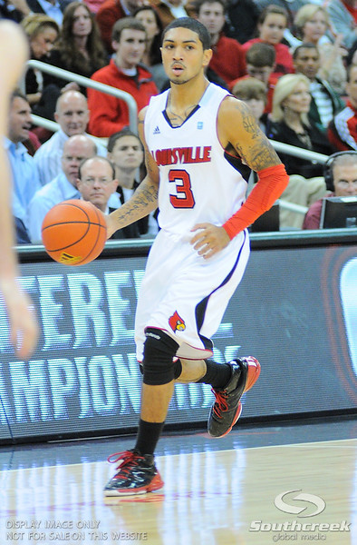 Louisville guard Peyton Siva (3) during the game.  Louisville leads Butler 41-23 at the half  at the KFC Yum Center in Louisville, Kentucky.