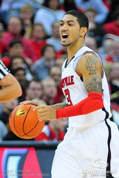 Louisville guard Peyton Siva (3) calling out the play during the game.  Louisville leads Butler 41-23 at the half  at the KFC Yum Center in Louisville, Kentucky.