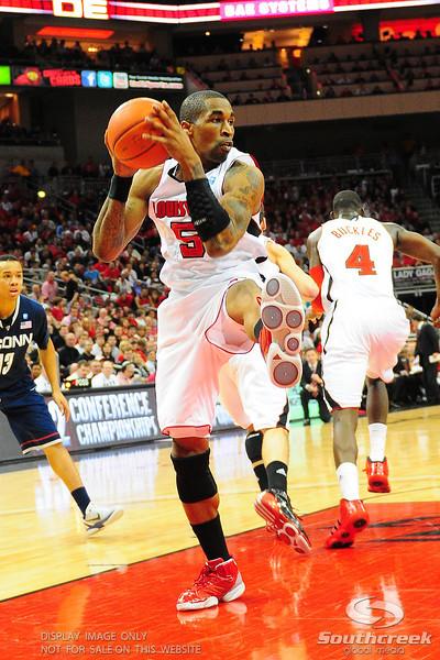 Louisville Cardinals guard Chris Smith (5) comes down strong for a rebound. (16) Louisville Cardinals defeated (13) Connecticut Huskies 71-58 at the KFC Yum Center in Louisville, Kentucky.