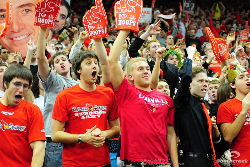 Louisville Cardinals fans celebrate during the game.  (16) Louisville Cardinals defeated (13) Connecticut Huskies 71-58 at the KFC Yum Center in Louisville, Kentucky.