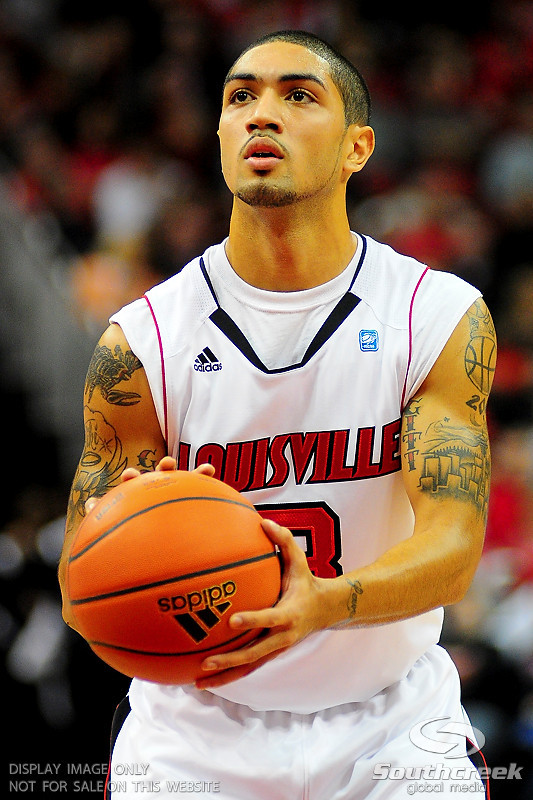 Louisville Cardinals guard Peyton Siva (3) shoots a free throw.  (15) Louisville Cardinals tied with DePaul Blue Demons 34-34 in the first half at the KFC Yum Center in Louisville, Kentucky.