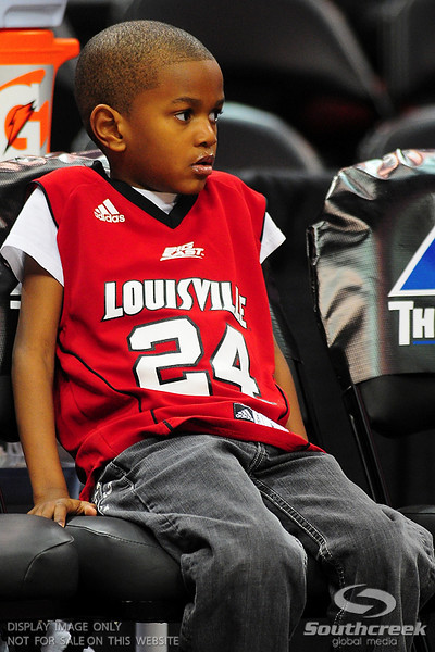 Louisville Cardinals sits on the bench before the game.  (15) Louisville Cardinals tied with DePaul Blue Demons 34-34 in the first half at the KFC Yum Center in Louisville, Kentucky.