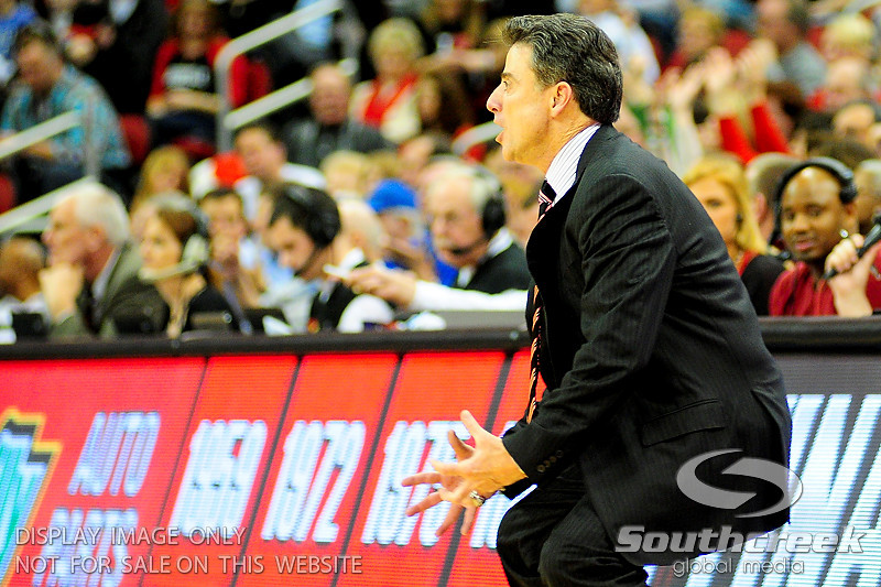 Louisville Cardinals head coach Rick Pitino was very intense during the game.  (15) Louisville Cardinals defeated DePaul Blue Demons 61-57 at the KFC Yum Center in Louisville, Kentucky.