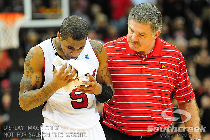Louisville Cardinals guard Chris Smith (5) was cut in the forehead during the game.  (15) Louisville Cardinals defeated DePaul Blue Demons 61-57 at the KFC Yum Center in Louisville, Kentucky.