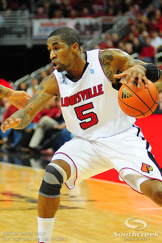 Louisville Cardinals guard Chris Smith (5).  (15) Louisville Cardinals tied with DePaul Blue Demons 34-34 in the first half at the KFC Yum Center in Louisville, Kentucky.