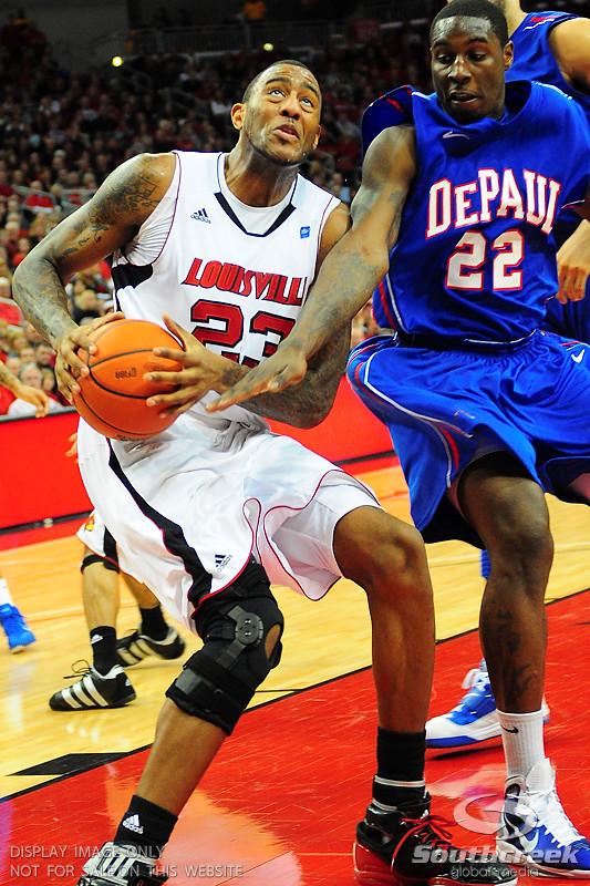 Louisville Cardinals forward Terrence Jennings (23) was strong under the basket.  (15) Louisville Cardinals defeated DePaul Blue Demons 61-57 at the KFC Yum Center in Louisville, Kentucky.