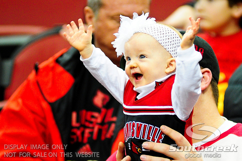 Louisville Cardinals fans start young.  (15) Louisville Cardinals tied with DePaul Blue Demons 34-34 in the first half at the KFC Yum Center in Louisville, Kentucky.