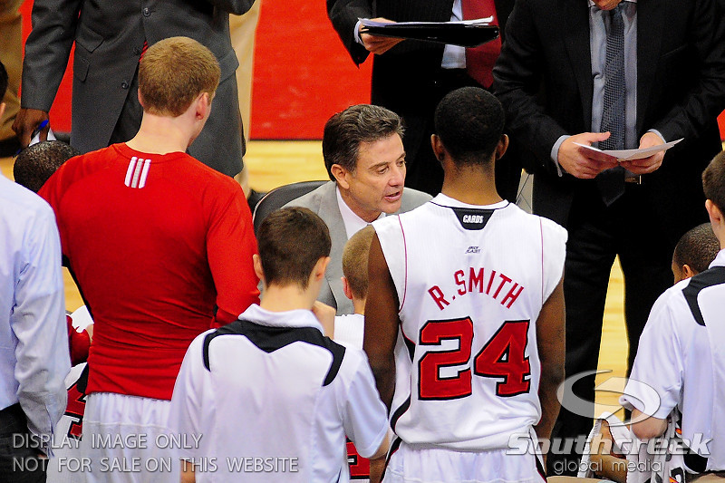 Louisville head coach Rick Pitino talks to his players during a time out.  (17) Louisville defeated Marquette 71-70 at the KFC Yum Center in Louisville, Kentucky.