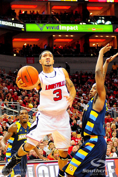 Louisville guard Peyton Siva (3) driving to the basket.  (17) Louisville defeated Marquette 71-70 at the KFC Yum Center in Louisville, Kentucky.