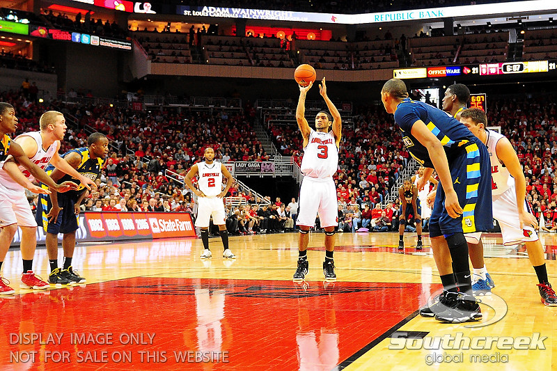 Louisville guard Peyton Siva (3) shooting a free throw.  (17) Louisville defeated Marquette 71-70 at the KFC Yum Center in Louisville, Kentucky.