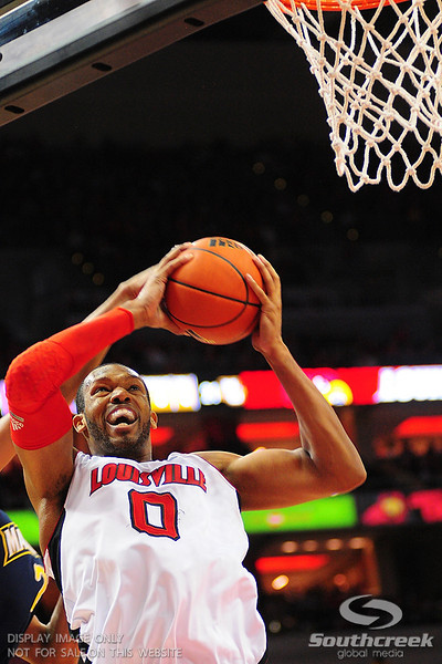 Louisville forward George Goode goes strong to the basket.  (17) Louisville defeated Marquette 71-70 at the KFC Yum Center in Louisville, Kentucky.