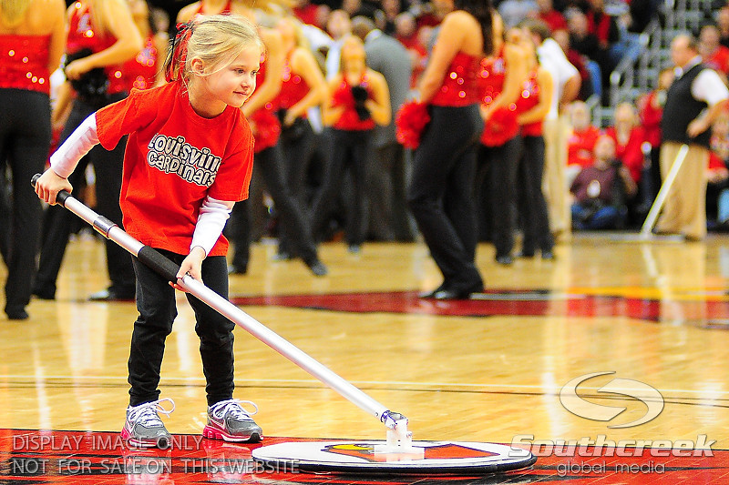 Louisville ball girl cleans the floor during a time out.  (17) Louisville defeated Marquette 71-70 at the KFC Yum Center in Louisville, Kentucky.