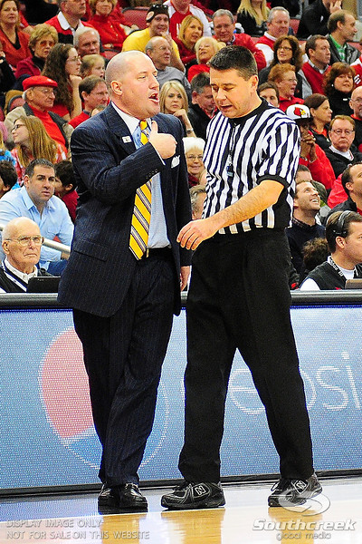 Marquette head coach Buzz Williams upset with the official.  (17) Louisville defeated Marquette 71-70 at the KFC Yum Center in Louisville, Kentucky.