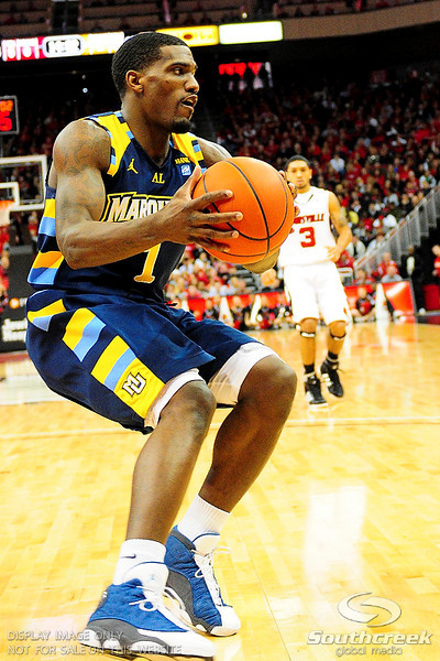 Marquette guard Darius Johnson-Odom (1) comes down with a defensive rebound.  (17) Louisville defeated Marquette 71-70 at the KFC Yum Center in Louisville, Kentucky.