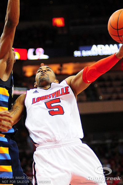Louisville guard Chris Smith (5) goes strong to the basket.  (17) Louisville defeated Marquette 71-70 at the KFC Yum Center in Louisville, Kentucky.