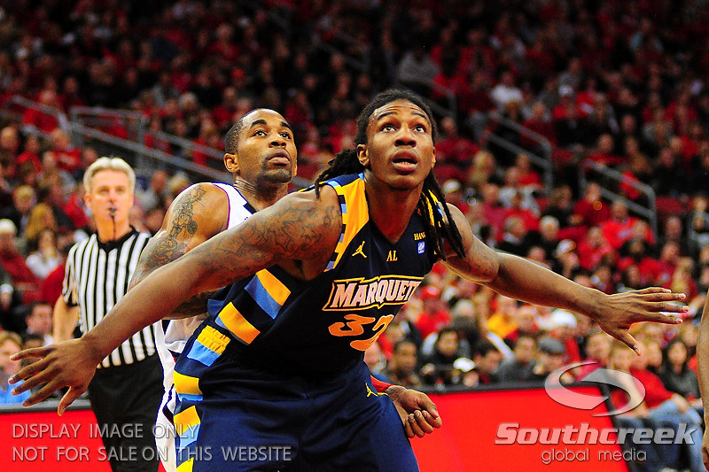 Marquette forward Jae Crowder (32) blocks out Louisville guard Chris Smith (5).  (17) Louisville defeated Marquette 71-70 at the KFC Yum Center in Louisville, Kentucky.