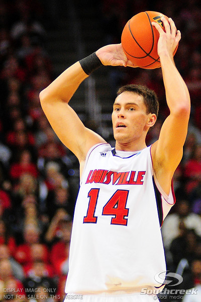 Louisville guard Kyle Kuric (14).  (17) Louisville defeated Marquette 71-70 at the KFC Yum Center in Louisville, Kentucky.