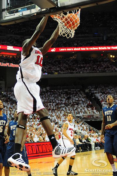 Louisville Cardinals center Gorgui Dieng (10) with a slam dunk.  (16) Louisville Cardinals (4) defeated Pittsburgh Panthers 62-59 at the KFC Yum Center in Louisville, Kentucky.