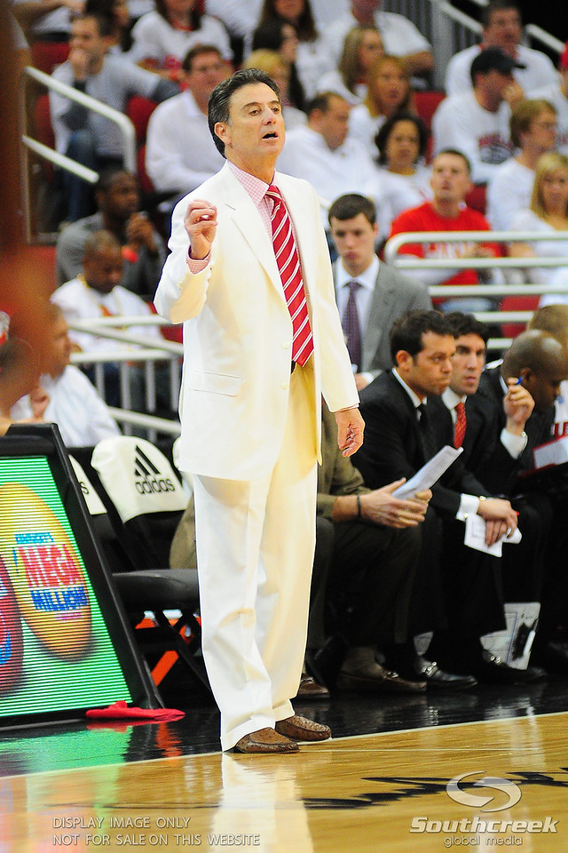 Louisville Cardinals head coach Rick Pitino wears a white suit for the white out.  (16) Louisville Cardinals Lead (4) Pittsburgh Panthers in the first half at the KFC Yum Center in Louisville, Kentucky.